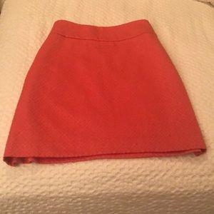 Short orange skirt with side pockets